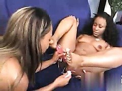 Black women getting her pussy toyed by her female lover