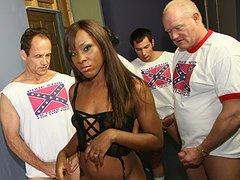 Ms Platinum in Black gang bang video.