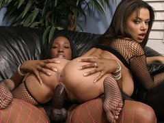 Ebony babes playing with a strap-on!