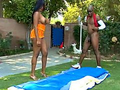 Busty ebony babe Essence, gets pussy liking in garden. Her nipples get hard when he sucks on them and her pussy is getting wet and ready for his cock. She's on heat and some hard fucking is all she wants.