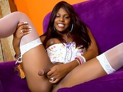 Ebony tgirl Brownie pleases her own cock